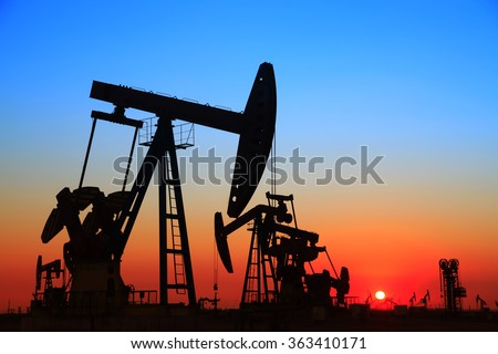 In the evening, the outline of the oil pump, it is very beautiful - stock photo