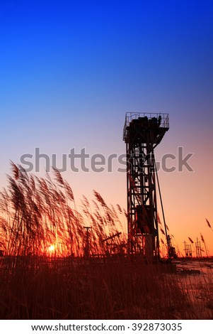 In the evening, the tower type pumping unit of silhouette