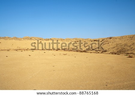In the foreground area, a barn for storage of sludge. - stock photo