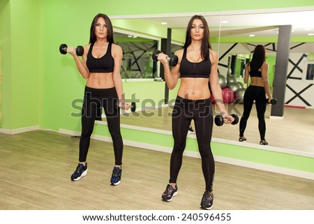 In the gym - girls are exercising in the gym