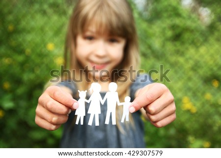 in the hands of the family on a background paper - stock photo