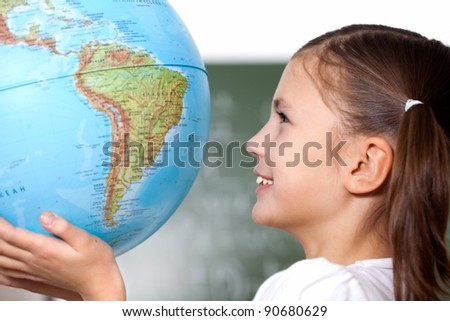 in the hands of the model of the Earth - stock photo