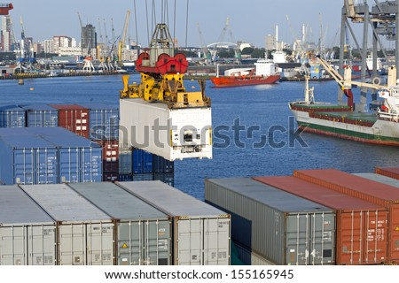 In the harbor of Rotterdam, Netherlands, container vessel being loaded - stock photo