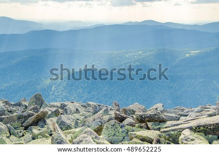in the high mountains clouds float. colorful mountain and cumulus clouds