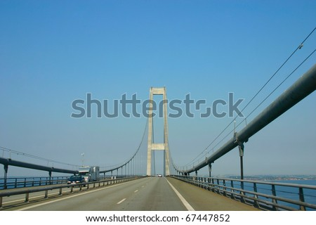 In the middle of the longest European Suspension bridge  (Storeb���¦ltsbroen) between the Danish islands of Zealand and Funen - stock photo