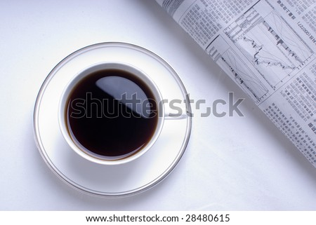 In the morning coffee and reading newspaper - stock photo