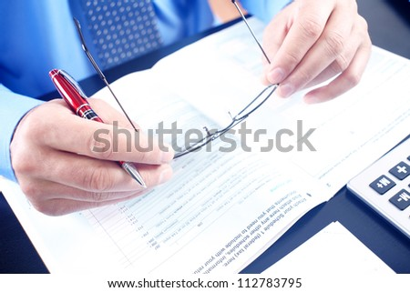 In the office. Businessman working with documents