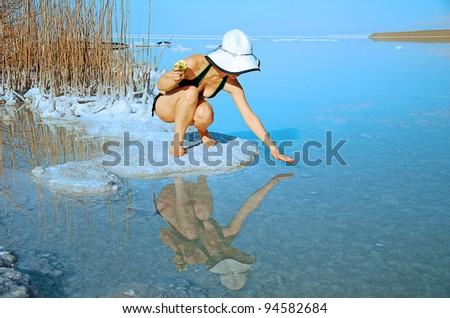 in the salty Dead Sea shore - stock photo
