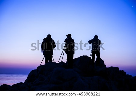 In the seaside, the silhouette of the photographer - stock photo