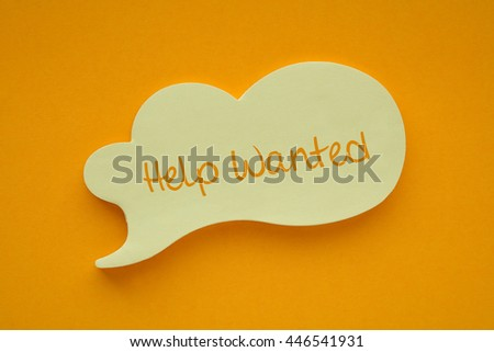In the speech balloon on a orange background Help Wanted writes - stock photo