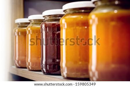 In the storeroom. More bottles of homemade jam. - stock photo