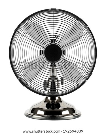 In the summer heat, the electric motor-driven fan refreshes the air. Can be used at home or in the workplace. - stock photo