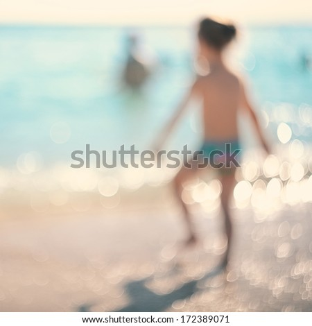 In the summer vacation.Silhouette of a girl running in the sea. - stock photo