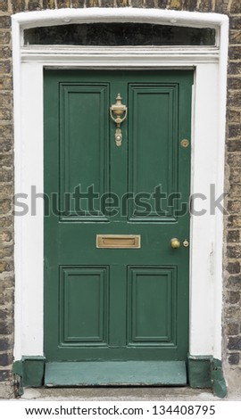 In the 18th century Hanoverian period, streets in Dublin were redesigned. Houses looked all very similar, so the doors were painted in different colors & given ornaments for their windows. - stock photo