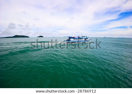 In the tropical sea. Andaman sea. Way from the phuket island to Phi Phi island. Thailand Kingdom.