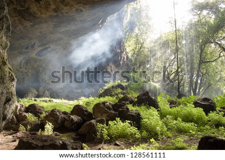In the Tutum Cave with waterfall, Sipi trail, Mount Elgon, Uganda - stock photo