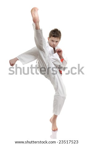 in your face kick - boy practicing self defense - stock photo