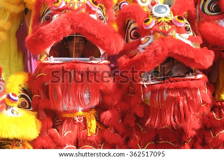 Inanam Sabah Malaysia - Feb 16, 2015: A lion dance parade in action at Manggatal Sabah during Chinese New Year Celebration (CNY).CNY is among major celebration in multiethnic Malaysian. - stock photo