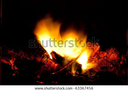 incandescent embers and flame on the black background