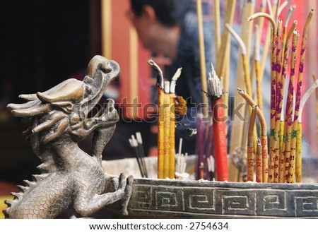 Incense burning at a temple during Chinese New Year celebrations in Qingdao, China. - stock photo