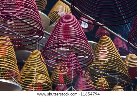 Incense coils burning in a chinese temple in Hong Kong - stock photo
