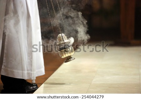 Incense during Mass at the altar - stock photo