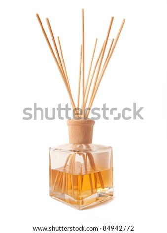Incense Oil Jar with Wood Sticks isolated on white background - stock photo