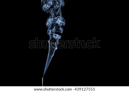Incense stick with smoke on black background - stock photo