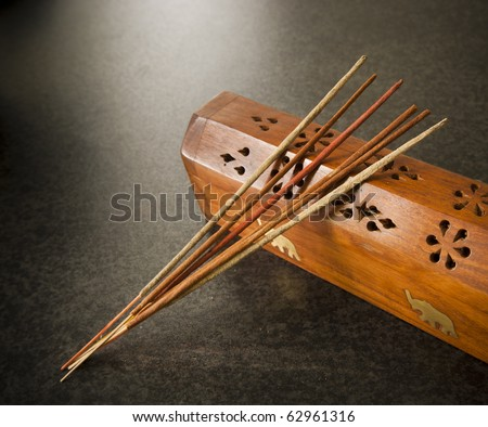 Incense sticks against a timber box
