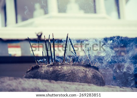 Incense sticks burning in a Buddhist temple - stock photo