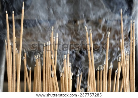 Incense sticks burning in front of an pagoda in Kyoto, Japan.Selective focus.  - stock photo