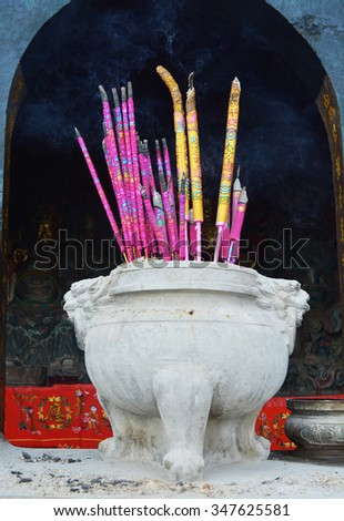 Incense sticks in Buddhist or taoism temple of china - stock photo