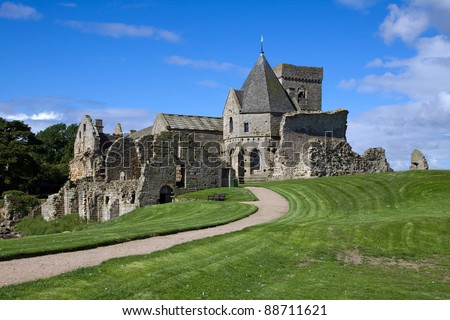 Inchcolm Abbey on the island of Inchcolm in the Firth of Forth near Edinburgh in Scotland. This picturesque ruin was founded in the 12th century and abandoned after the Scottish Reformation in 1560. - stock photo
