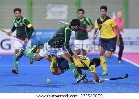 INCHEON, Korea, 30 September 2014: Pakistan hockey team in action against the Malaysian hockey team when playing in Seonhak Hockey Stadium, at the Asian Games 2014, Incheon, South Korea.