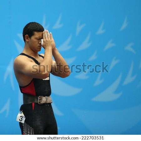 INCHEON - SEP 25:Sarat SUMPRADIT  of Thailand participates in 2014 Incheon Asian Games at Moonlight Festival Garden Weightlifting Venue on September 25, 2014 in Incheon, South Korea.