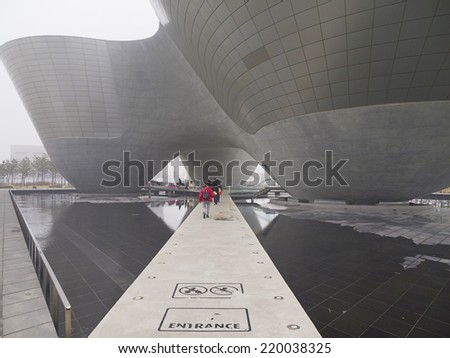 INCHEON, SOUTH KOREA -MAR 30: Visitors visit Incheon Tri-bowl Building on Mar 30, 2012 in Songdo district, Incheon, South Korea. This architecture is a remarkably shaped exhibition and performance space. - stock photo
