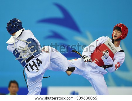 INCHEON,SOUTH KOREA - OCT 02: LEE Daehoon (r) of South Korea in action during Men's -63 kg Taekwondo final of the 2014 Asian Games at Ganghwa Dolmens Gym on October 02, 2014 in Incheon, South Korea. - stock photo