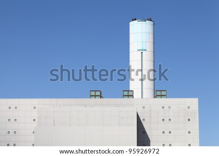 Incineration plant with chimney - stock photo