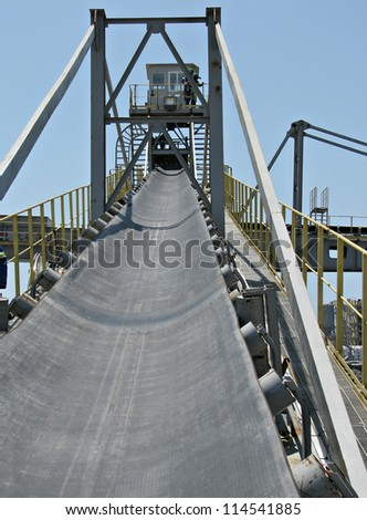 incline conveyor with rubber belt - stock photo