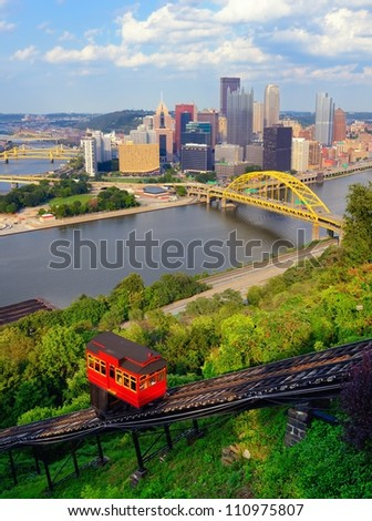 Incline operating in front of the downtown skyline of Pittsburgh, Pennsylvania, USA.