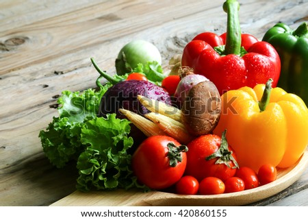 Include vegetables on wooden floor