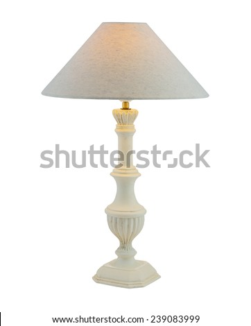 Included table lamp with shade on a wooden leg isolated on white - stock photo