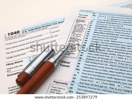 Income tax form and pen. Finance concept. over a white background