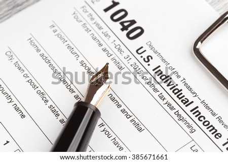 Income Tax Return Form with fountain pen