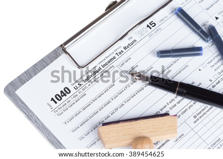 Income Tax Return Form with fountain pen and rubber stamp