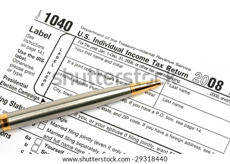 Income tax return with pen.