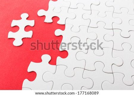 Incomplete puzzle with missing pieces - stock photo