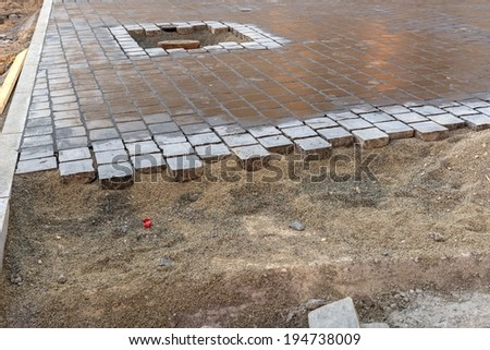 Incomplete road with small stones and sand - stock photo