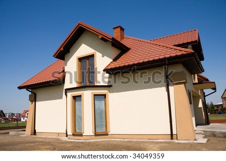 Incomplete single family small yellow house - stock photo