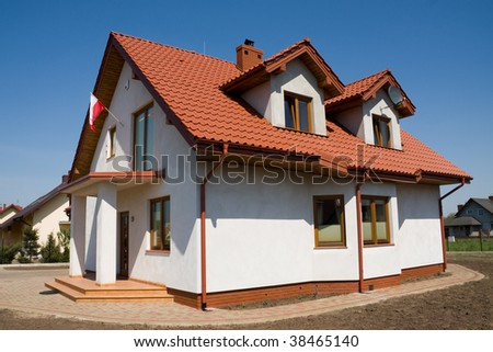 Incomplete small white house, still under construction - stock photo